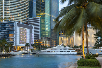 EB-5 Regional Center in Florida. Photo of a boat pulled up right along skyscrapers in Miami, Florida.